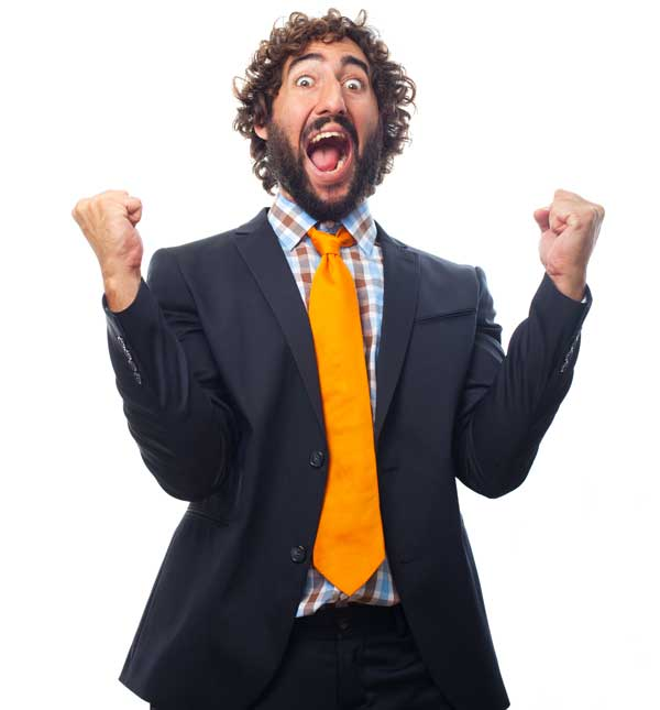 Bearded man in a suit celebrating a risk-free betting win